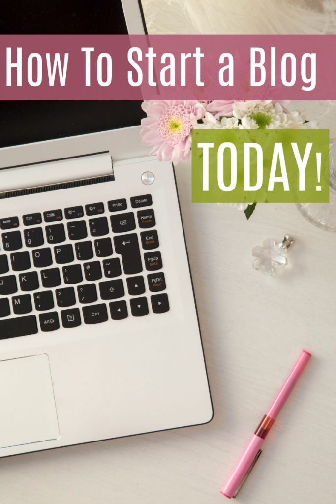 Laptop on desk with pink chrysanthemum flowers