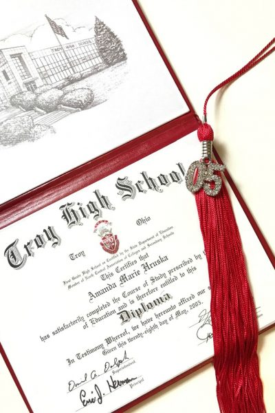 High school graduation diploma and status tassel
