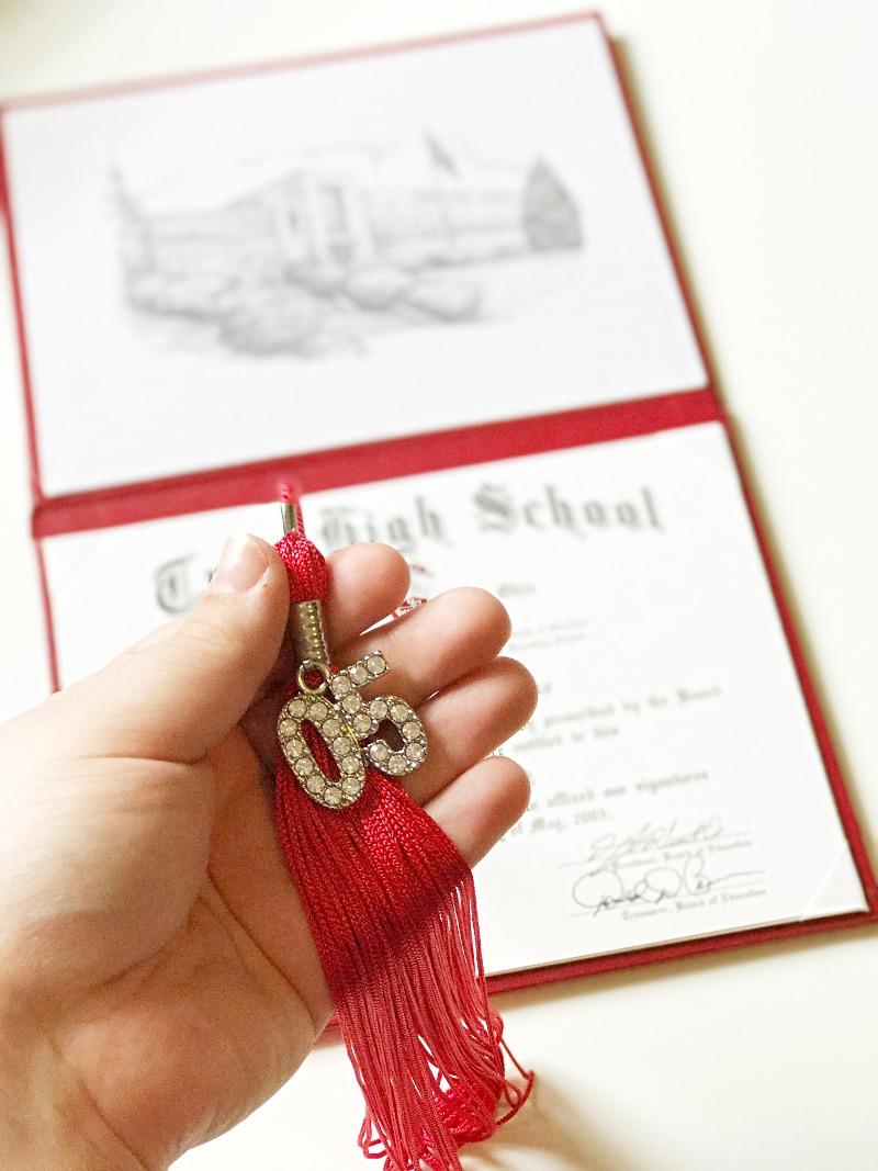 holding graduation tassel