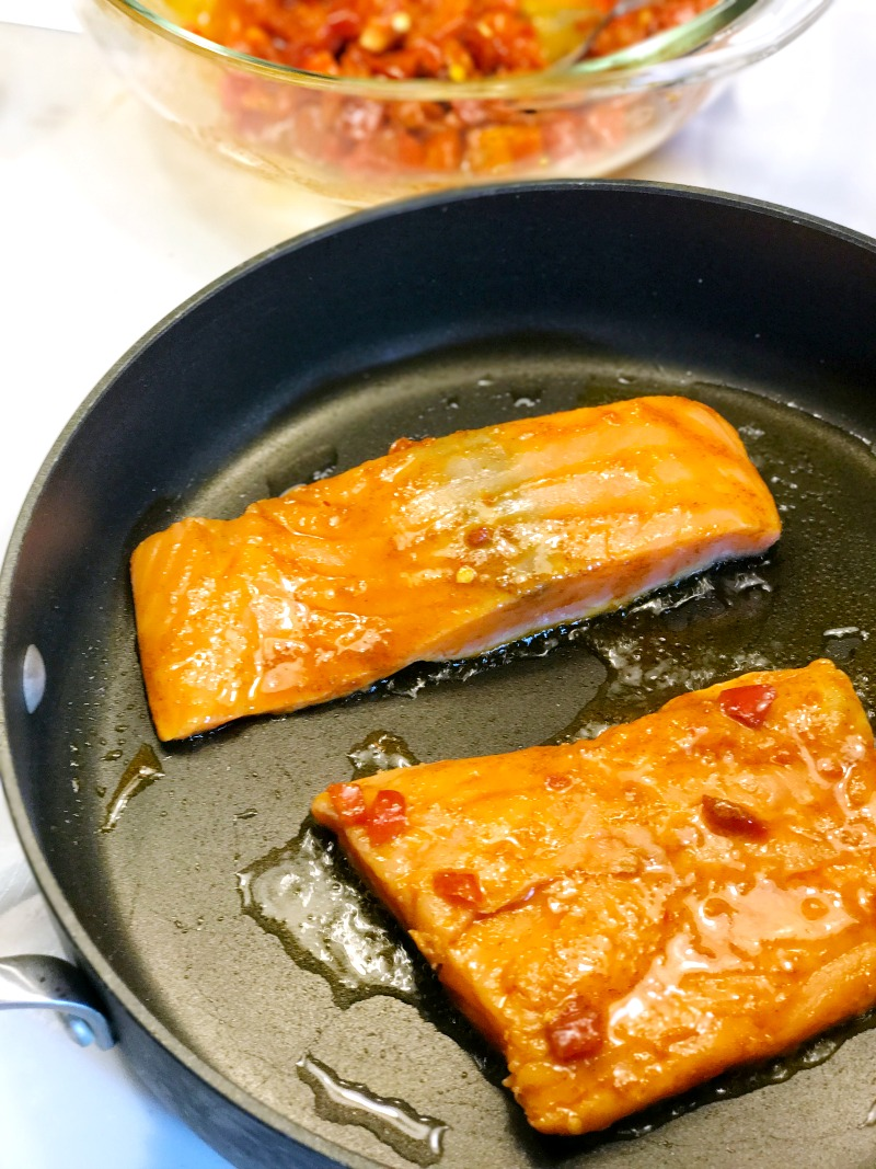 Kroger Prep+pared Peruvian inspired salmon cooking in pan
