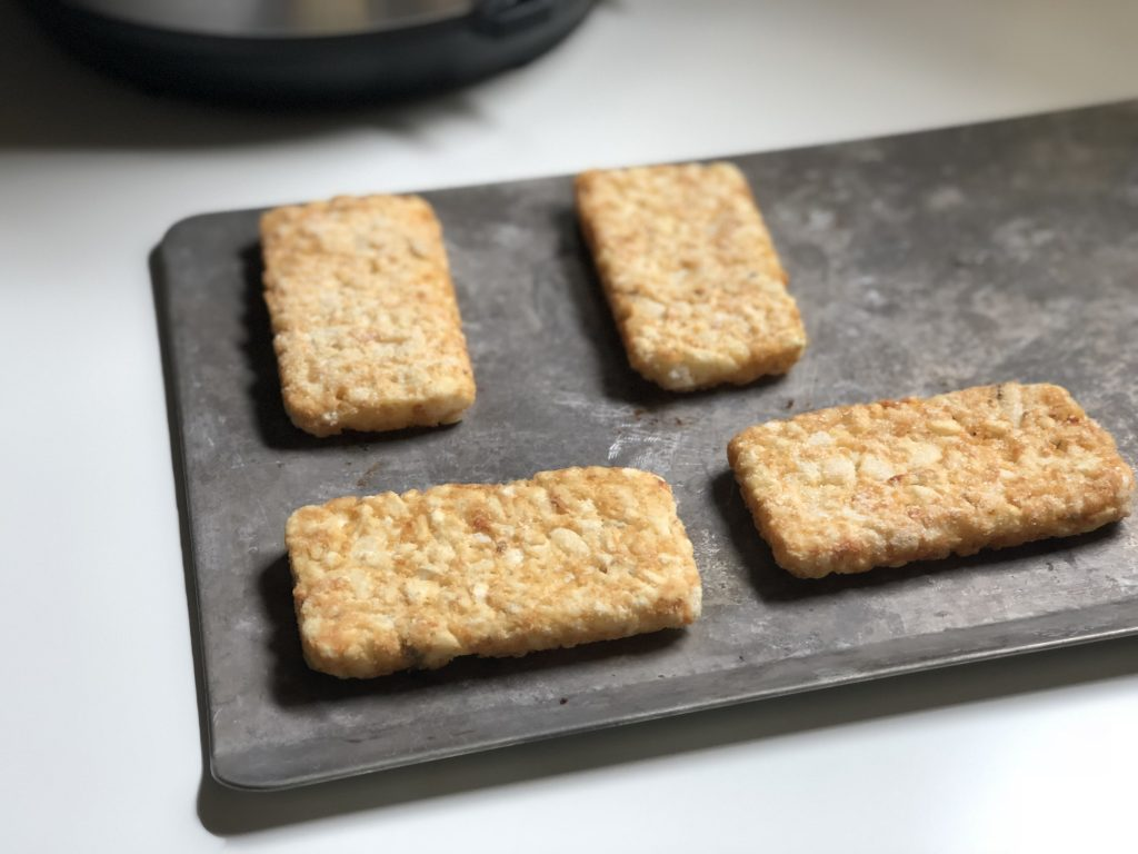 Hashbrown patties on baking sheet