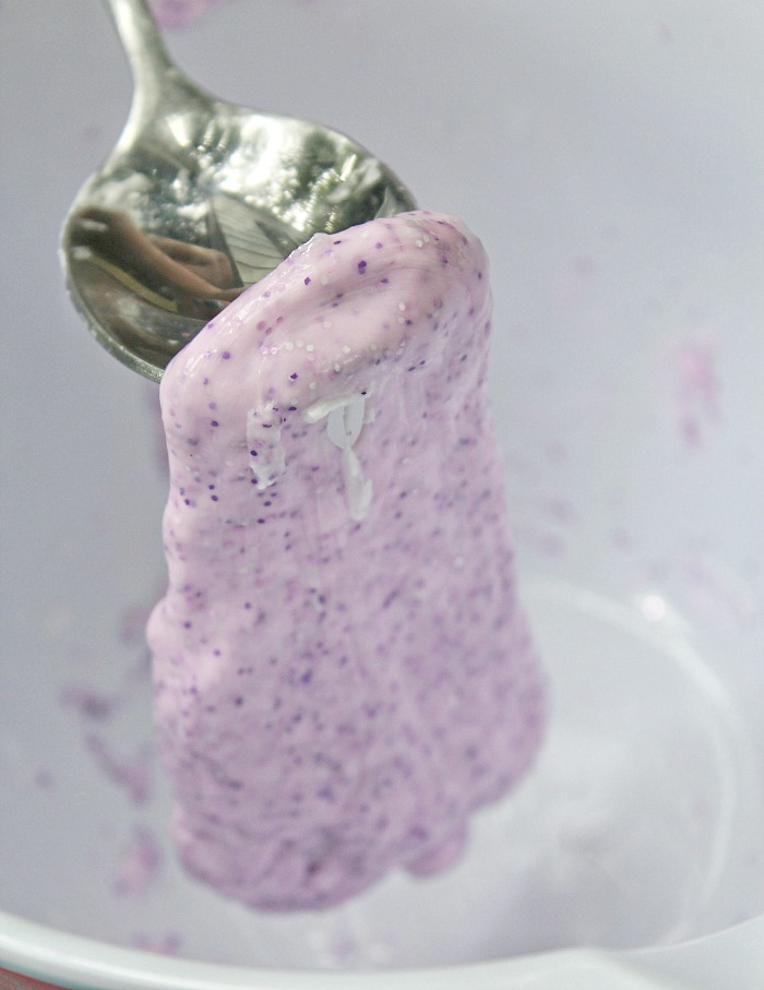 spoon hlding diy purple glitter slime