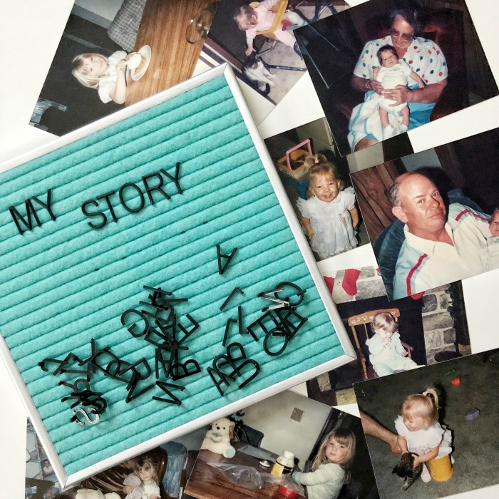 teal letterboard with baby photos